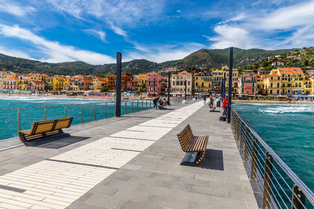 View Of Mole Leading To The Town Of Alassio Full Of Colorful Buildings During Summer Day-Alassio,Italy,Europe
