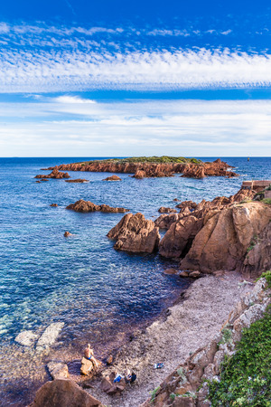 panoramatic: Red rocks of Esterel Massif and island in the late afternoon summer light-French Riviera, Provence-Alpes, Cote dAzur, France