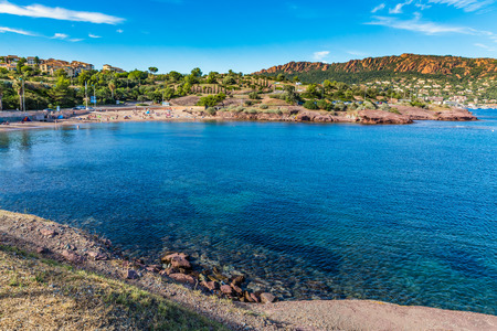 panoramatic: Village, Beach And Trees Among Red Rocks of Esterel Massif During Sunny Day-French Riviera, Provence-Alpes, Cote dAzur, France