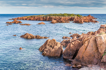 Red rocks of Esterel Massif and island in the late afternoon summer light-French Riviera, Provence-Alpes, Cote dAzur, France