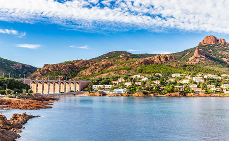 View of Antheor City With Railway Bridge and Red Rocks of Esterel Massif During Summer Day-French Riviera, Provence-Alpes, Cote dAzur, France