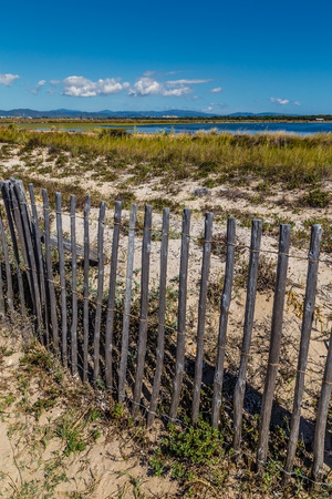 sel: View Of Giens Peninsula With Fence Around Salt Pan During Sunny Day-Hyeres,France