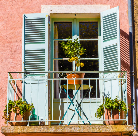 Detail Of Balcony With Green Door And Small Lemon Tree On The Table-Tourtour,France,Europe