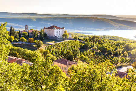 View Of Aiguines Village And Renaissance-style Chateau Overlooking Lac de Sainte Croix Lake-Alpes de Haute Provence,France Stock Photo