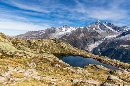 aiguille: View Of Lac des Cheserys And Mountain Range With Aiguille du Tour, Aiguille du Chardonnet, Aiguille d Argentiere, Aiguille de l A Neuve-France