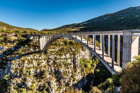 luberon: A beautiful concrete arch Artuby  bridge perched between the cliffs of the Artuby River-Alpes Cote de Azur, Provence,France