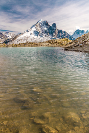 lac: View Of Lac Blanc And Aiguille Verte Mountain -France Stock Photo