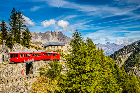 france station: Beautiful View Of Red Train Going To Montenvers Mer de Glace Station During Summer Day-Mont Blanc Massif,Chamonix,France