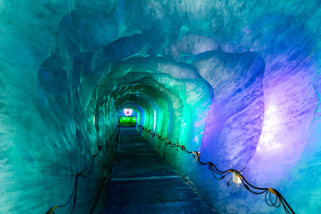 Colorful Icy Corridor In Ice Cave Digged Inside Mer De Glace Glacier-Mont Blanc Massif,Chamonix,France Stock Photo
