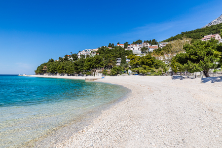 Beautiful Empty Sandy Beach During Sunny Summer Day - Baska Voda, Makarska, Dalmatia, Croatia Stock Photo
