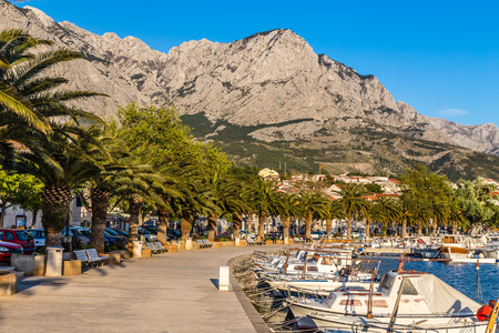 seafront: Seafront Promenade With Yachts And Palms And Biokovo Mountain In The Background  - Baska Voda, Makarska, Dalmatia, Croatia Stock Photo