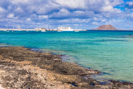rocky coastline: Rocky Coastline And Port - Corralejo, Fuerteventura, Canary Islands, Spain