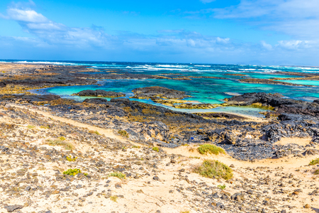 Rocky Coastline With Turquoise Lagoons - El Cotillo, Fuerteventura, Canary Islands, Spain Stock Photo
