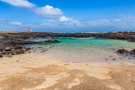 Toston Lighthouse And Rocky Seashore - El Cotillo, Fuerteventura, Canary Islands, Spain