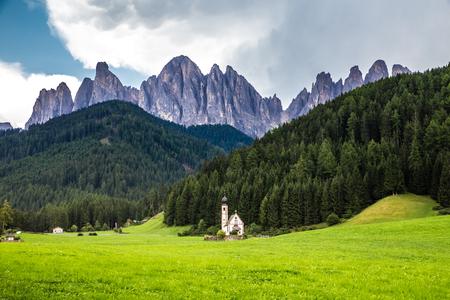 Church of St. John of Nepomuk And Geisler (Odle) Dolomites Peaks - Santa Maddalena, Val Di Funes, Tyrol, Italy Stock Photo