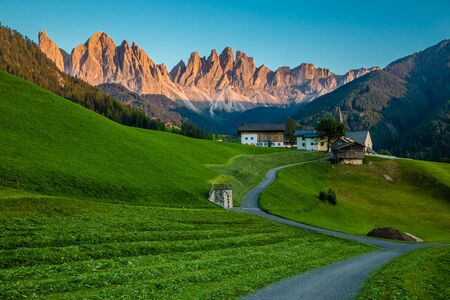 Val Di Funes And Geisler (Odle) Dolomites Mountain Peaks During Sunset - Val Di Funes, South Tyrol, Italy 版權商用圖片
