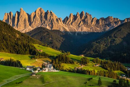 Santa Maddalena Church And Geisler (Odle) Dolomites Mountain Peaks During Sunset - Val Di Funes, South Tyrol, Italy