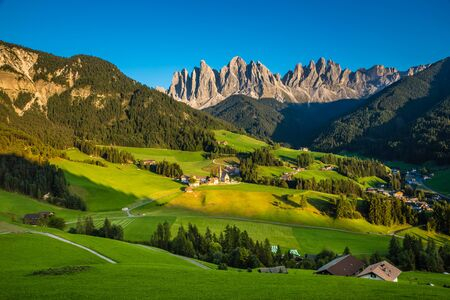 Val Di Funes And Geisler (Odle) Dolomites Mountain Peaks During Sunset - Val Di Funes, South Tyrol, Italy Фото со стока