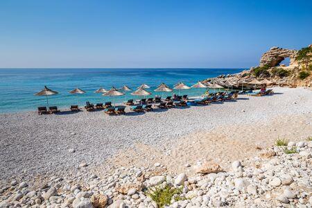 Sunbeds And Umbrellas On Dhermi Beach - Dhermi, Himarë, Vlore, Albania 写真素材