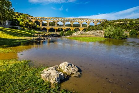 Roman Aqueduct Pont du Gard Over Gardon River - Nimes, France, Europe