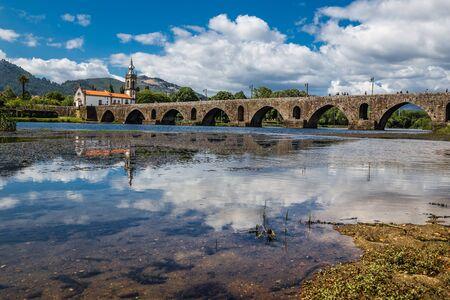 Church Of Santo António Da Torre Velha And Medieval Bridge Crossing River Lima - Ponte De Lima, Alto Minho, Portugal, Europe Stock Photo