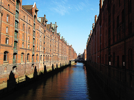 Hamburg city warehouse with red brick buildings, traveling. Banco de Imagens