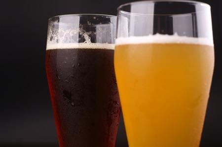 pilsner beer: Closeup shot of two glasses of beer Stock Photo