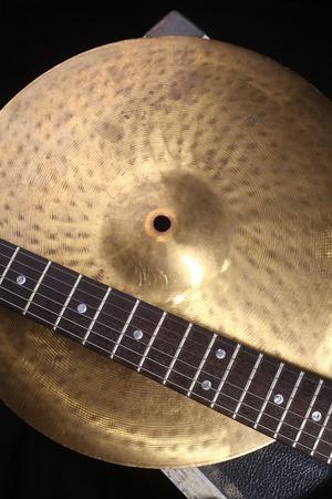 cymbal: Closeup of an electric guitar and a cymbal Stock Photo
