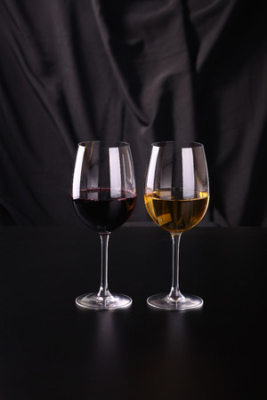 redwine: Glass of white and red wine over a dark background