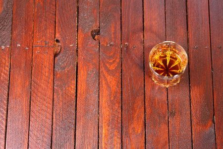 tumbler glass: Tumbler glass full of whisky standing on a wooden table Stock Photo