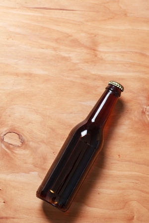 no label: Beer bottle with no label on a textured wooden surface Stock Photo