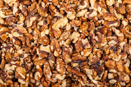 Close up shot of a pile of crushed walnut