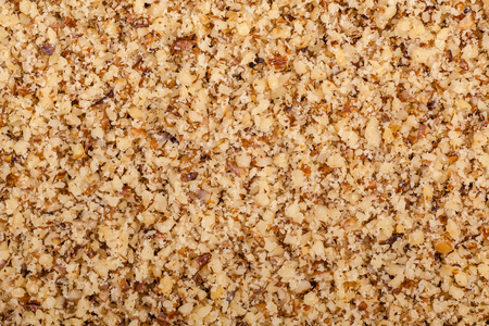 Close up shot of a pile of finely ground walnut