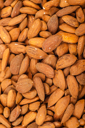 Close up shot of a pile of almond nuts Stock Photo