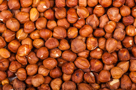 Close up shot of a pile of hulled hazelnuts Stock Photo