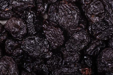Close up shot of a pile of dried prunes