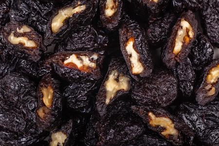 Close up shot of a pile of dried prunes stuffed with walnuts