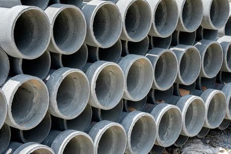 to arrange: Arrange cement pipe in stock warehouse Stock Photo