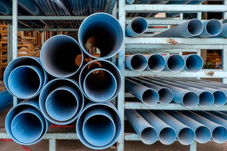 dusty: Dusty blue pipe pvc in stock shelf Stock Photo