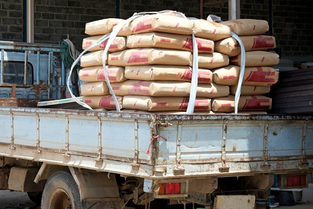 Heap of cement bags waiting for transport to customer