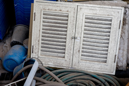 disordered: Old dirty cabinet door in disordered warehouse