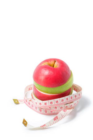 slice red and green apples with waist measure on white background.space for adding your text.