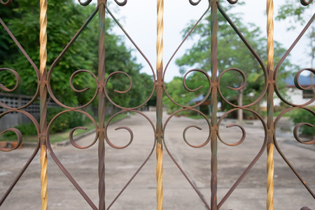 safty: Curved steel made from fence. with nature trees background.