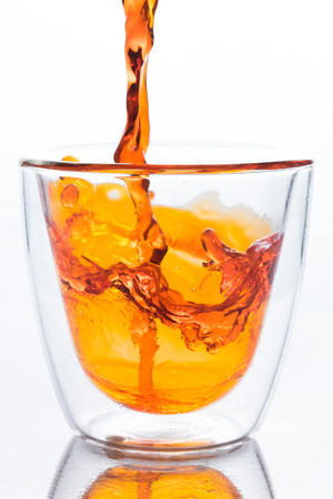 orange water: pouring orange water in to clear two layers glass, this orange water look like whisky, spirits