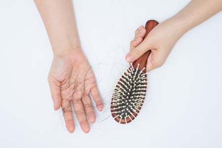 brush hair: Hair loss in woman hands and bruch, on white background, women postpartum defluvium
