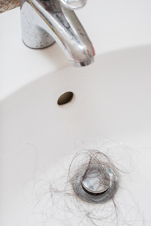 Hair loss problem in white sink.