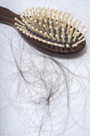 Hair loss problem on bruch, on white background, women postpartum defluvium Reklamní fotografie