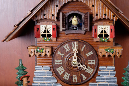 Cuckoo clock with birdie out of house made by crafted wooden Reklamní fotografie - 44305211