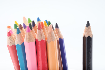 Colored pencils on white background.