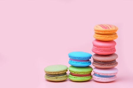Sweet and colourful french macaroons on pastel pink background Reklamní fotografie